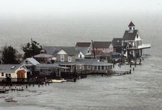 row of houses stands in floodwaters at Grassy Sound in North Wildwood, New Jersey, as Hurricane Sandy pounds the East Coast. (AP Photo/The Press of Atlantic City, Dale Gerhard