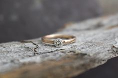 Silver Diamond and 14k Rose Gold Solitaire Ring by GlobalPathways on Etsy https://www.etsy.com/listing/221556577/silver-diamond-and-14k-rose-gold