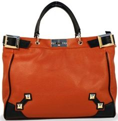Gunas' burnt orange tote w/ detachable long strap and red suede lining. VEGAN! I am loving this bag, it's my daily go-to.