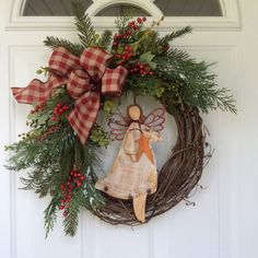 Christmas Wreath-Angel Wreath-Primitive Christmas Wreath-Holiday Wreath-Christmas Gift-Rustic Wreath-Woodland Christmas-Christmas Angel This rustic angel wreath captures the simple joy and wonder of the season. This is the perfect wreath to tuck into a little spot in your home needing some Christmas cheer and would also make a wonderful gift to a special person in your life. Realistic faux evergreen boughs, cedar, seeded eucalyptus and bright red berries create a seasonal background for a…