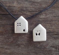 little houses - could be made from porcelain clay (homemade) and added to beaded chain.