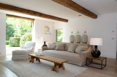 Classic Belgian style.  Long linen sofa, long rustic wooden table and loose cover armchair.  Timeless and understated.  All items of furniture are available from www.behomecollection.com 0845 257 9070