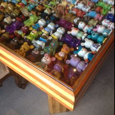 Vinylmation display table. Not bad, not bad. Would maybe need a mirror underneath so I could see the back of them.