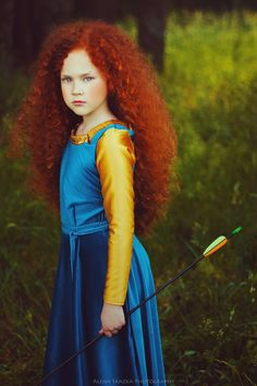 very beautiful little girl, love her red hair!