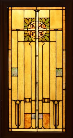 An Antique American Arts and Crafts Style Stained Glass Panel set in Zinc came.  The panel is very striking with Gold Iridized accents and a very dramatic Gold glass setting off the central elements.