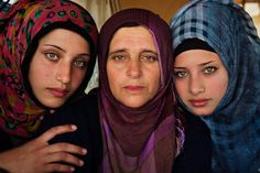"""PHOTOGRAPHER: Mihaela Noroc ~ wrote, """"I visited the Idomeni refugee camp in Greece, where I took this photo with a Syrian mother and her daughters"""""""
