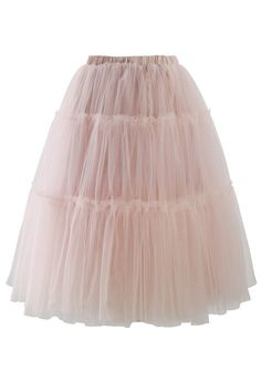 - Multi mesh tulle pom pom style skirt - Very stretchable waistband - Slip on - Lined - 100% Polyester