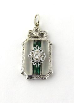 Vintage 14K White Gold Diamond and Synthetic Emerald Camphor Glass Pendant This pendant looks like a wrapped present with green ribbon, and a white