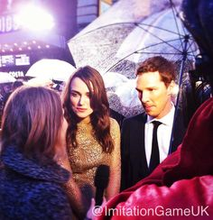 LONDON FILM FESTIVAL (October 8, 2014) ~ Keira Knightley & Benedict Cumberbatch under an umbrella in the rain on the red carpet at the European premiere of THE IMITATION GAME.