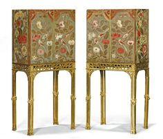 18th C. cabinets in the manner of Thomas Chippendale, doors covered in chinoiserie flock wallpaper.