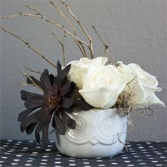 Make this spooky floral arrangement for Halloween.  It's easy and inexpensive to make.