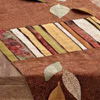 Download the free instructions to create the charming table runner from Aug/Sept '11 Sew News.