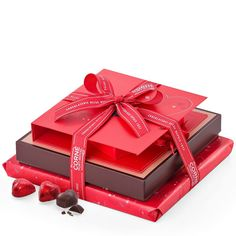 é -    :Surprise your beloved for #Valentine's with this Corné Port-Royal #chocolate tower. A trio of chocolate gift boxes is tied up with a signature red ribbon for a romantic #gift set