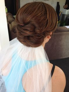 Wedding up-do with underneath veil