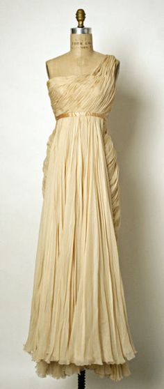 Jean Dessès dress ca. 1949-1950 via The Costume Institute of the Metropolitan Museum of Art. Jean Dessès (1904–1970), was a world leading fashion designer in the 1940s, 1950s and 1960s. His designs reflected the influences of his travels, specializing in creating draped evening gowns in chiffon and mousseline, based on early Greek and Egyptian robes.