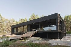 Modern minimalist seaside vacation residence designed by Haroma & Partners situated in Kustavi, Finland.