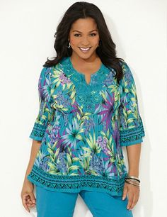 Tropical Pleasted Blouse: Spice up your wardrobe with this bright tunic in a tropical summer print with a geo border. Cascading pleats gracefully release at the hem for a feminine finish. Medallion crochet trim at neckline. Three-quarter sleeves. catherines.com #catherines #plussizefashion #summerstyle