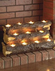 Southern Enterprise Burning Log Fireplace Candelabra - Re-create the rustic charm of a wood fire with the clever Southern Enterprise Burning Log Fireplace Candelabra . This handcrafted resin sculpture resembles. Fireplace Candelabra, Fireplace Lighting, Fireplace Logs, Fireplace Inserts, Fireplace Ideas, Fireplace Filler, Diy Faux Fireplace, Fireplace Decorations, Christmas Fireplace