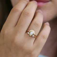 Pear opal engagement ring adorn with white diamonds. bohemian, feminine and unique. Pear Cut Engagement Rings, Engagement Ring Buying Guide, Wedding Rings Vintage, Diamond Wedding Rings, Gold Wedding, Bohemian Wedding Rings, Trendy Wedding, Wedding Bells, Seed Pearl Ring