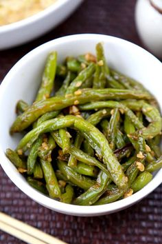 Dry-Fried Green Beans with Garlic Sauce - Pickled Plum Food And Drinks- This is an easy and classic preparation for Chinese dry-fried green beans sauteed in soy, garlic and sesame oil. Tasty, salty, and tender dry-fried green beans – the best! Air Fried Green Beans, Soy Sauce Green Beans, Asian Green Beans, Chinese Green Beans, Sauteed Green Beans, Garlic Green Beans, Side Dish Recipes, Vegetable Recipes, Asian Recipes