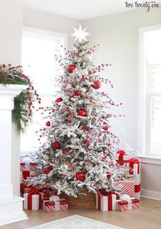 Flocked Christmas tree with red and white and silver ornaments #flockedtree #christmastree