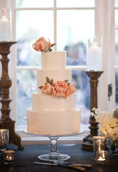 Four-tiered smooth buttercream wedding cake with sugar peonies and sugar foliage at DeLille Cellars.