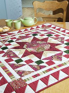 Welcome guests and family to the table with this cheerful little patchwork quilt! Red Robin's elegant design and sparkling star make it the perfect accent quilt for any surface, or even used as a wall hanging quilt.
