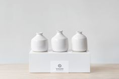 A curated set of three individually shaped bud vases. Each vase is turned  by hand on the potter's wheel and is thoughtfully formed. Reveal your  designs by unwrapping the natural linen satchels. The one of a kind  assortments make for a wonderful and unmatched wedding or housewarming  gift.