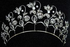 Fabergé Cyclamen Tiara:  The Jewel came from the workshops of the chief jewellery workmaster of Faberge, Albert Holmström in 1903. It was purchased from Faberge for the Hon. Mrs. Wilson Fox. The tiara can be effortlessly removed from its gold frame and worn as an articulated fringe necklace.  It is now in the family jewel collection of the Duke and the Duchess of Westminster.