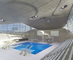 The London Aquatics centre, iconic modern concrete architecture design by Zaha Hadid for Stratford at the London Olympics. Designs and images featured on Martyn White Designs Interior Design blog. Images courtesy of Hufton + Crow