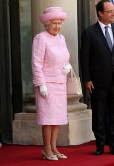 Elegant in a powder pink coat and matching hat, the Queen was every inch the style icon as she was welcomed to Paris by France's President Hollande at the Elysee Presidential Palace during an Official visit ahead of the 70th Anniversary Of The D-Day on 05.06.2014 in Paris, France.