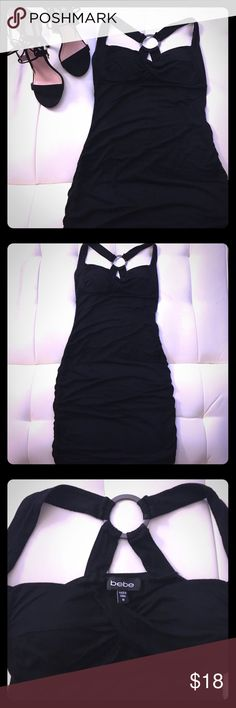 Black Bebe hater dress Form fitting black Bebe halter dress. Built in padding on bra area. Super soft  very stretchy material. Size medium. Cute dress for a night on the town. bebe Dresses