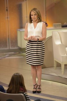 Katie's silky in stripes wearing this Elie Tahari blouse and Banana Republic skirt on her show with Vanna White!