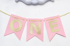 SHIPPING NOTES: PLEASE LEAVE EVENT DATE/DATE NEEDED IN NOTES TO SELLER! Thank you!! ************** This Pink and Gold banner is the perfect addition to any birthday party or photo shoot! Hang on a wall, mantle, high chair or use in the background for the birthday pictures.