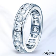 Style 2136 Platinum diamond eternity band handcrafted with 18 round diamonds in a channel setting. #eternityband