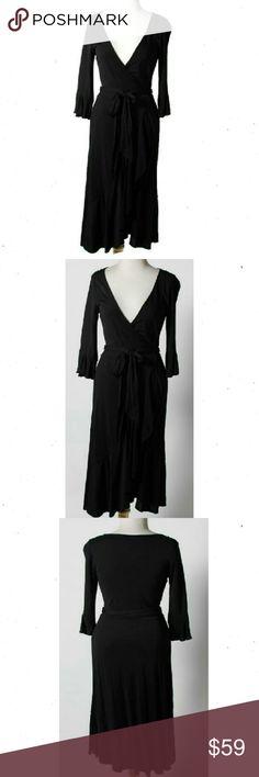 "Diane von Furstenberg Little Black Dress Diane Von Furstenberg Black Wrap adjusted by belt tie. 1/2 half sleeve black dress, mid Calf length (5'7"").  Single ruffled edging around base of sleeve, bottom half,  and base of dress. Dress Size 2 Fabulous dress to dress up or casual. Excellent Condition. 85% Viscose 15% Polyamide.  Flat lay Measure Shoulder to Shoulder: 12.5"" Armpit to Armpit: 14"" Sleeve Length: 16.5"" Total Length: 46"" Diane von Furstenberg Dresses"