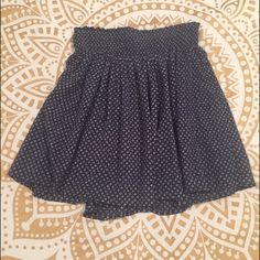 Navy Skirt w/ White Pattern Great condition navy skirt with little white pattern. You can dress it up or dress it down and it has perfect comfort for any outfit! Old Navy Skirts