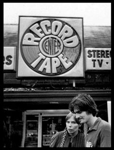 Joni Mitchell and James Taylor, in front of a record store