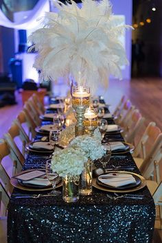 When you combine feathers, candlelight, sparkly black + gold glamorous decor, and Great Gatsby Wedding details, the end result is magic. Gatsby Wedding Decorations, Gatsby Theme, Wedding Themes, Wedding Centerpieces, Wedding Events, Wedding Ideas, Wedding Planning, Event Planning, 1920s Wedding Decor