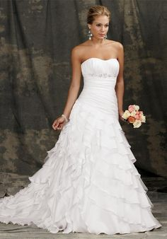 Gown features beading and ruching. Available with zipper or lace-up back.