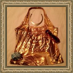✨Gold Shimmery Halter Top✨ Sexy lil halter top. Gold, bronze and brown tones Excellent Condition Worn Once. Squared neckline. Swirled design. Polyester spandex stretch material. Perfect for night out on the town Vixen Tops