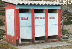 A separate older trio of latrines is still used by teachers and kids.