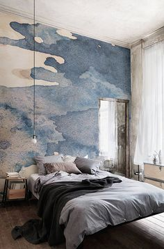 Bring a whole new meaning to bedroom headboards with this watercolour wallpaper. Indigo tones fade into a warm, earthy canvas background. Giving you an understated yet stylish wall mural that's perfect for bedroom spaces.