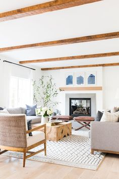 Living room with pops of blue and lots of warm white and natural woods