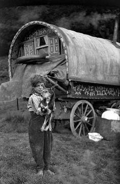 Gypsy boy and dog, England. 1920