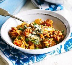 Tomato & chorizo risotto - A truly easy weeknight dinner, this rice dish is like a simple paella or jambalaya - add broad beans or sweetcorn for extra colour Bbc Good Food Recipes, Dinner Recipes, Cooking Recipes, Healthy Recipes, Rice Dishes, Pasta Dishes, Main Dishes, Risotto Receita, Chorizo Recipes