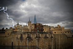 """""""Juxtaposition of Time"""" by Kristina Austin Scarcelli.  The Tower of London (circa 1078) viewed from the Brass Mount. Rising above in the background, the Shard skyscraper (circa 2009) can be seen, creating a juxtaposition of nearly 1,000 years of history."""