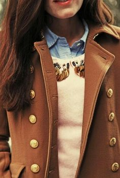 Love the layers and especially the buttons and military style of the coat!