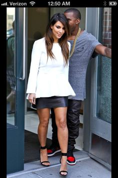 Kim K wearing a lot of black and white lately. But can't deny this is super in right now- peplum and leather.