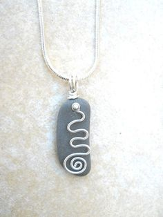 Wire Wrapped Jewelry Sterling Silver Spiral Lake Superior Beach Stone Pendant Necklace. $30.00, via Etsy.
